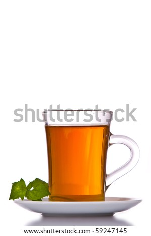 cup with tea and mint on a white background. - stock photo