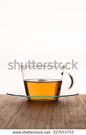 Cup with  tea on the wood table - stock photo
