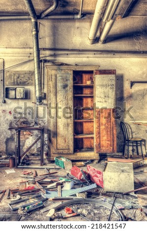 Cupboard in an abandoned derelict workshop, HDR - stock photo