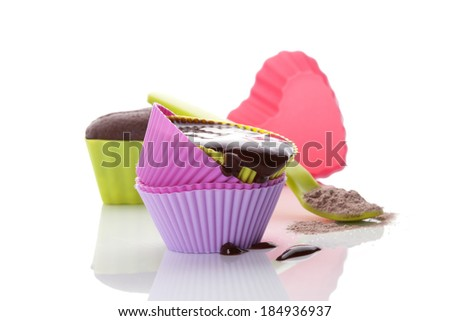 Cupcake chocolate mixture in neon colored baking forms isolated on white background. Culinary cupcakes baking. - stock photo