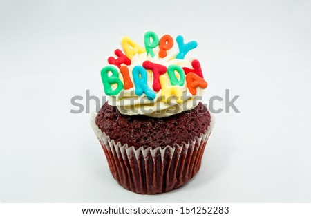 Cupcake decorated with birthday candles - stock photo