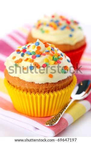 Cupcake decorated with sugar sprinkles - stock photo