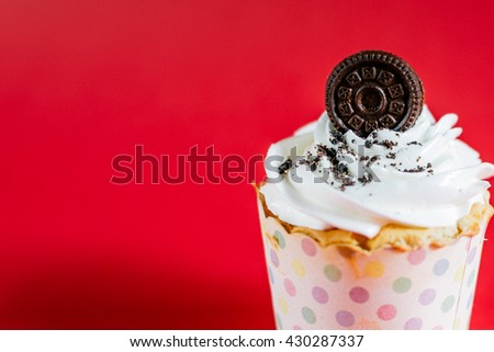 Cupcake on a red background.Cupcake with space.birthday cake,close up  - stock photo