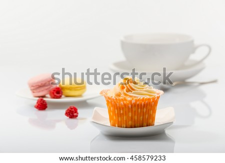 Cupcake on background tea set - stock photo