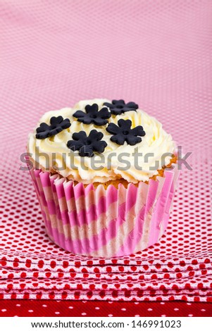 Cupcake on red background - stock photo