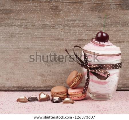 Cupcake towel give away with macaroons - stock photo