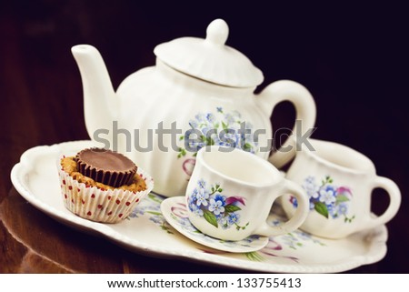 Cupcake with a note tea pot and cup of coffee - stock photo