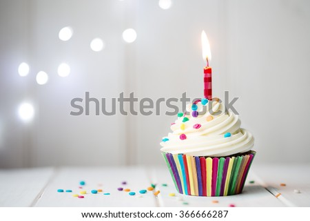 Cupcake with a single candle - stock photo