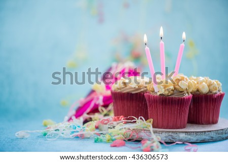 cupcake with birthday candle, copy space background - stock photo
