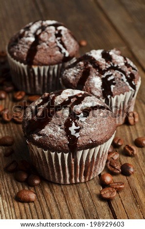 Cupcake with chocolate on wooden background - stock photo