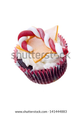 Cupcake with frosting candy cane and star toppings - stock photo