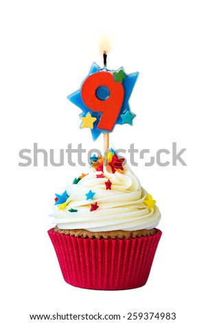 Cupcake with number nine candle - stock photo
