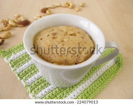 Cupcake with nuts from microwave  - stock photo
