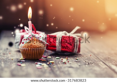 Cupcake with present gifts - happy birthday card/ Holidays greeting card - stock photo