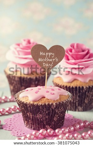 Cupcake with rose flowers for Mother's Day - stock photo