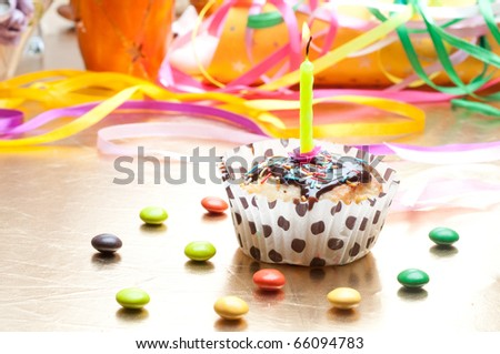 cupcake with sprinkles and candle. birthday - stock photo