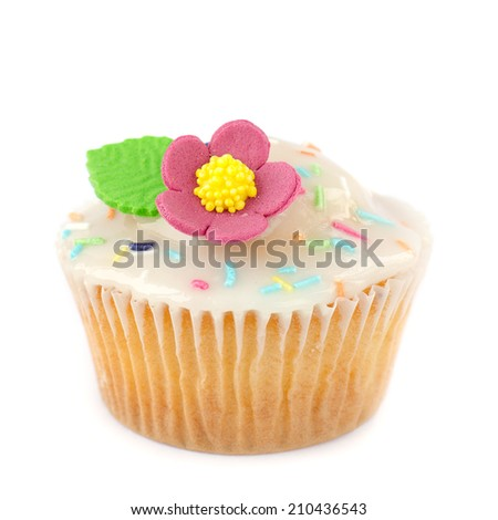 Cupcake with sugar frosting, sprinkles and  flower isolated  - stock photo