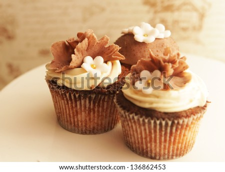 Cupcakes - caramel, chocolate and nuts - stock photo