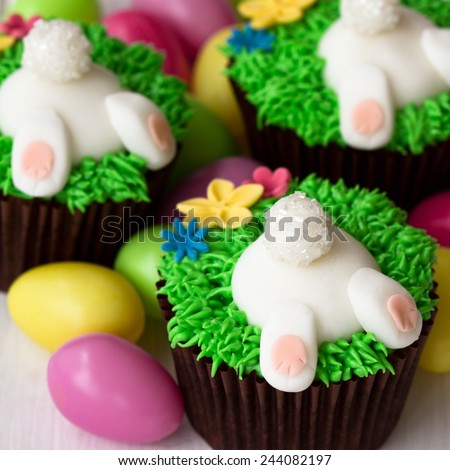 Cupcakes decorated with fondant Easter bunnies - stock photo