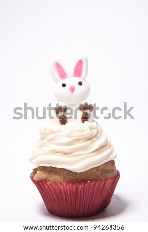 Cupcakes with a bunny on top for Easter - stock photo