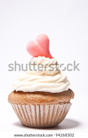 Cupcakes with a pink heart on top - stock photo