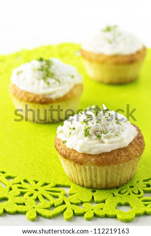 Cupcakes with coconut and lime frosting - stock photo