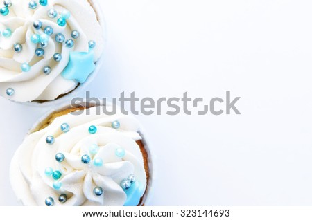 Cupcakes with frosting and decorations on white background  - stock photo