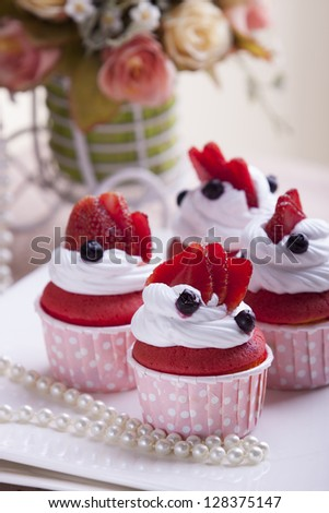 Cupcakes with Strawberry, blueberry and whipped cream - stock photo