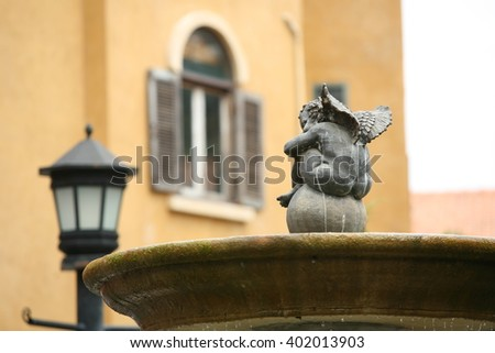 cupid angel  sleeping waiting somthing - stock photo