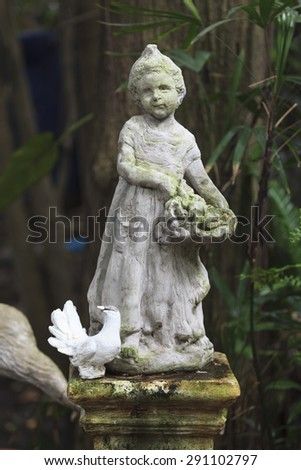 Cupid Statue sculpture in the garden. - stock photo
