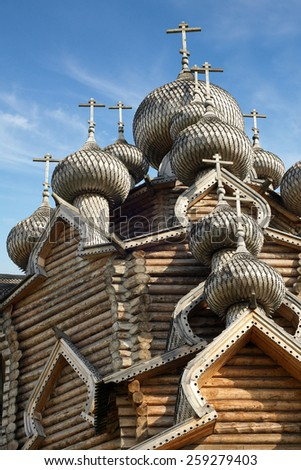 Cupolas of wooden Christ Orthodox church, a vertical picture - stock photo