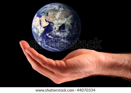 Cupping the Earth. Earth image courtesy of NASA Visible Earth: http://visibleearth.nasa.gov - stock photo
