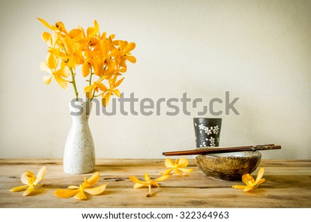 Cups and chopsticks with flower, home decoration concept - stock photo