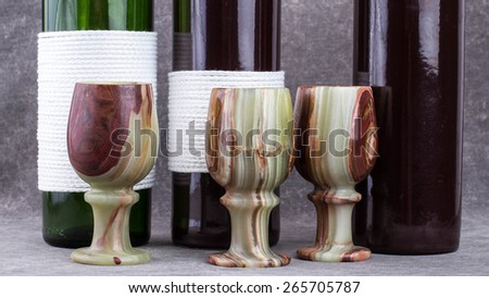 Cups made of natural stone handmade. - stock photo