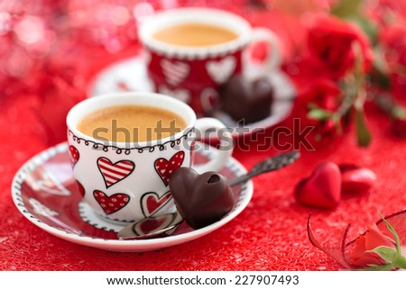Cups of coffee and roses for Valentine's day. - stock photo