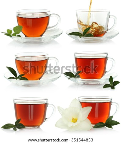 Cups of tea set with green leaves on a white background   - stock photo