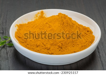 Curcuma powder in the bowl - stock photo