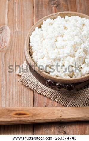 curd in brown bowl on wooden table background. - stock photo