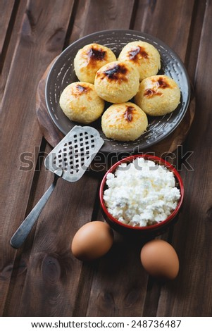 Curd pancakes and ingredients, high angle view - stock photo