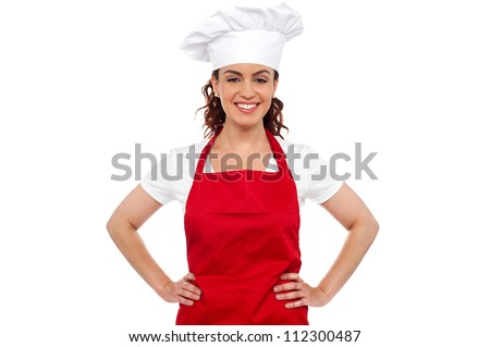 Cure female chef posing with hands on her waist. Calm and relaxed - stock photo