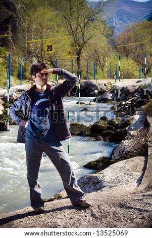 Curios man at river Treska - stock photo
