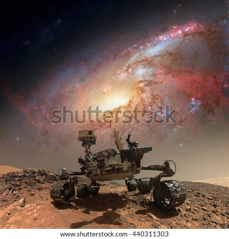 Curiosity rover exploring the surface of Mars. Retouched image. Elements of this image furnished by NASA. - stock photo