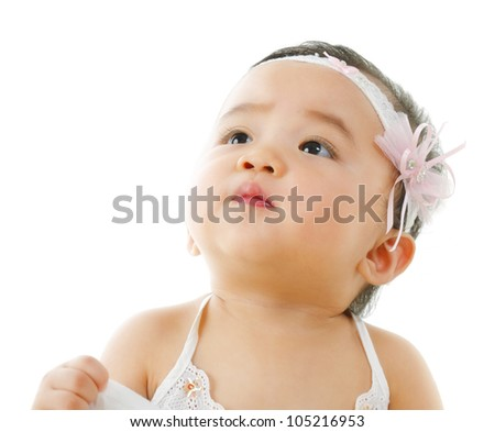 Curious asian baby girl looking up, isolated on white background - stock photo