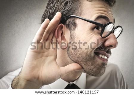 curious businessman listens - stock photo