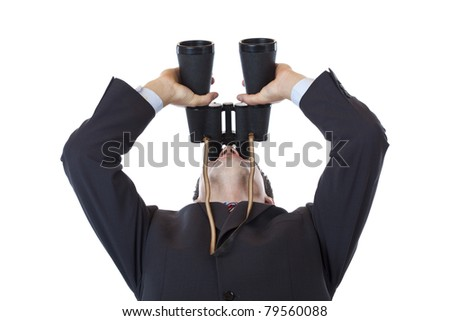 Curious businessman turns binoculars up to the sky.Isolated on white background. - stock photo