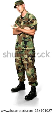 Curious Caucasian Soldier In Green Camouflage Uniform talking with hands - Isolated - stock photo
