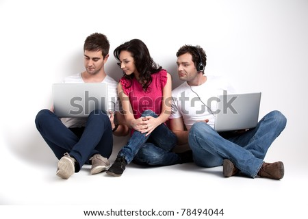curious friends looking at laptop - stock photo