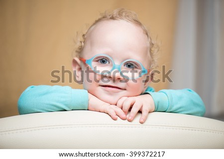 Curious kid with glasses - stock photo