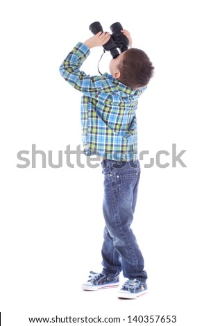 Curious little boy is looking left up through binoculars isolated over white background - stock photo