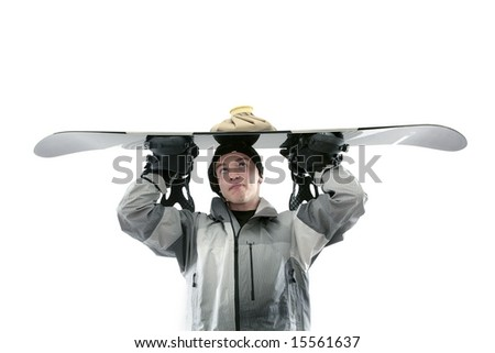 Curious looking snowboarder with board over head - stock photo